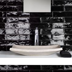 Pictures of different types of design for bathrooms with subway tiles.