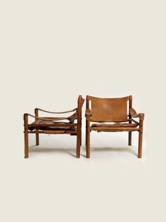 An exceptional pair of Arne Norell safari chairs in brown leather and rosewood