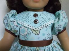 I just got these adorable aqua shoes in stock, and had to make a dress to match!! This dress is a combination of two coordinating fabrics in pale aqua with brown accents. The main part of the dress is a floral print, and the hem band and pointed collar/yoke, is a tiny pin dot. Both the