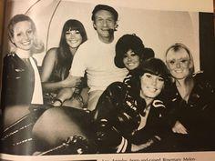 Hugh Hefner and the Bunnies on the Playboy private jet. (c. 1970)