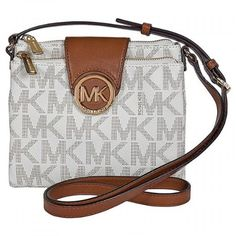 This authentic Michael Kors handbag is made of logo-embossed PVC. This Michael Kors Fulton Crossbody features a top zip and magnetic snap closure, adjustable shoulder strap, an all over MK logo print, gold-tone hardware and logo plaque, interior zip and two slip pockets, six credit card slots and an