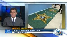 Florida sheriff's office rug says 'In dog we trust' by mistake