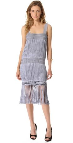 1,750.00 Silky fringe shimmers through the simple profile of this flapper-inspired Moschino dress, landing below the hem for a swingy finish.