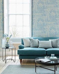Despite it being a cooler tone a light blue colour scheme could be your best bet as it goes without saying using pale colours in a light-deprived room can make it look brighter. Blue Living Room Decor, Living Room Color Schemes, Blue Color Schemes, My Living Room, Living Room Designs, Light Blue Sofa, Sofa Living, Monochromatic Room, Sofa Colors