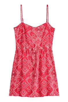 Robe sans manches: Robe courte sans manches en tissu avec partie ajourée devant. Modèle avec fines bretelles réglables, découpe à la taille et jupe évasée. Non doublée.