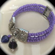 All jewelry is handcrafted with glass beads and silver plated accents. Bracelets are made with amemory wirematerial and easy clasp closure, so it will fit all