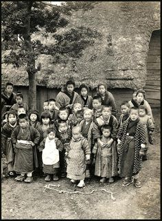 These kids seem orderly enough, and are keeping a respectable distance from the camera.  On the other hand, if Enami had brought out a bag of candy, he and his camera would probably have been trampled to death by those little ones --- starting with the little boy front and center.  The above is a half-stereoview, listed in Enami's 3-D Catalog as,  S 765 A GROUP OF CHILDREN IN A TEMPLE YARD.      A variant taken during the same country session as the above may be seen HERE as a nice old…