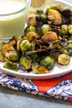 Harissa Brussels Sprouts with Lemon Garlic Aioli | girlinthelittleredkitchen.com