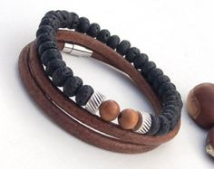 This bracelet consists of two separate layers. The first layer has dark brown and black lava beads. This layer is elastic - it is very easy to wear.  The second layer is 5 mm brown rustic round leather bracelet with a magnetic clasp. 2 x times around the wrist.  Both bracelets in the picture is 19 cm wrist size  If you need a different size, please let me know after purchase in note for seller. Please measure carefully your wrist and select the most preferable size.  Please look at my other…