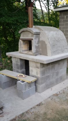 outdoor wood fired pizza oven completed  for less than $400 from scratch. His Italian  ancestral skills came out.   he laid cinder blocks and poured the concrete top leaving an opening for an ash grate.  He used heavy duty Styrofoam  to form the dome. fire brick was used for the base and over the dome shape. wood wedges were used between the brick on top and concrete mix dobbed in all the open spaces. He used a thinner mix to spread over the brick .   chimney was made from a ceramic drain…