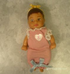 Barbie Happy Family Baby Krissy Brunette Doll. Dressed in pink sleep sack with white trim. Adorably sweet face. Brown eyes-ethnic.