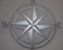 Nautical compass, hand drawn & laser cut from metal.