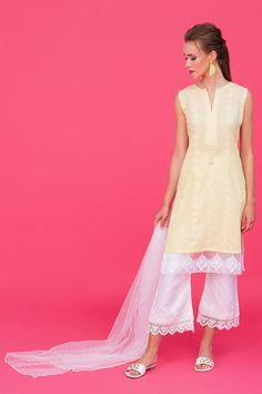 Model: 5'8 - 177 cm and 123 lbs - 56 kg size XS Estimated delivery time for this dress is 5-8 days The must-have yellow dress to complete your summer wardrobe –this gorgeous pastel yellow chikan kurti is going to add life to your seasonal revamps. The organza patch at the borders and pearl tassel buttons on the necklin Yellow Fabric, White Fabrics, Yellow Dress, White Dress, Kurti, Shalwar Kameez, Pastel Yellow, Flare Pants, Pakistani Dresses