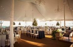 Wedding ideas and decorations.  Outdoor, elegant tent wedding.  Romantic Reception with simple navy and gold accents