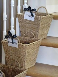 Personalized baskets are placed on the steps to collect stuff that belongs upstairs.