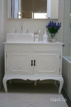 French provincial cabinet converted to bathroom vanity