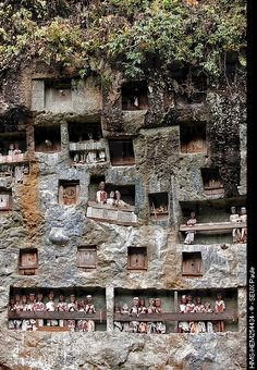 Torajaland - Sulawesi - Located in the mountains with it's wooden coffins and earthly goods are buried in caves hewn into the limestone cliffs.