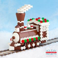 Canadian LEGO artist Chris McVeigh (previously) is celebrating the holidays by offering up the schematics for a tiny vintage arcade machine that doubles as a Christmas tree ornament. McVeigh has created some other seasonal LEGO projects, including the Gingerbread Express train engine.