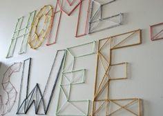 Inspiratie wanddecoratie, benodigheden spijkers een hamer en gekleurde bollen garen/wol