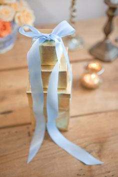 Baby blue and gold wedding bonbonniere.