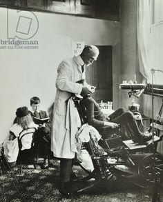 Deptford Children's Centre: dental surgeon at work, 1911 (b/w photo).