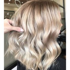Champagne Balayage | We love a glass of champagne to celebrate a special occasion (or just weekend brunch), but the bubbly drink is now making its way into salons—in the form of a gorgeous new hair color. Apparently, hair colors inspired by drinks are already a thing, and champagne hair is just the latest pin to tack on to 2018's hair color trends. You might picture champagne hair as simply another blonde but it's much more versatile. It does have a blonde slant, but it can work on light