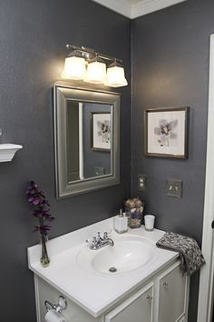 gray walls with silver mirror and purple accents= love!