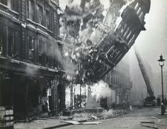 """Bomb damage to 23 Queen Victoria Street during the Blitz. """"The Salvation Army International Headquarters stood on Queen Victoria Street. It was photographed as its facade fell to the ground. Old London, London City, Vintage London, London Wall, Le Blitz, Blitz London, Photos Du, Cool Photos, Amazing Photos"""
