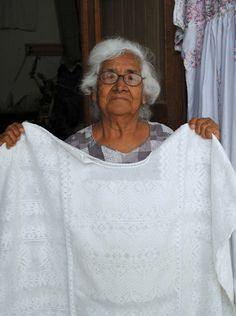 https://flic.kr/p/8YXAcS | White Huipil Oaxaca | This lady is a long time textile dealer in the city of Oaxaca, Mexico. In August, she showed me a few of her most prized garments. Among them is this white on white cotton huipil woven in Xochistlahuaca (suljaa) Guerrero