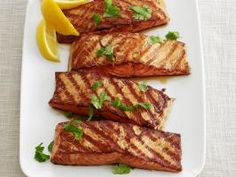 Moroccan Grilled Salmon : North African flavors permeate this healthful salmon dish: Marinate it in yogurt, lemon, garlic, coriander and cumin, then garnish with fresh cilantro.