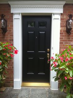 Amazing White Classy Paneled Pilaster Front Door Trim With White Plinth Block With Necking For Black Entry Swing Doors Also Pair Of Wall Lights Fixture Outdoor Brick Wall Facade Ideas