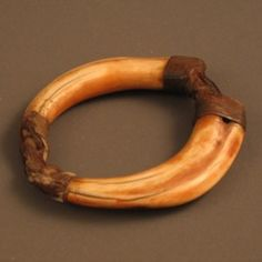 Africa   Ivory Bracelet from the Lotuko people of Sudan   Warthog tusks, leather and fiber.