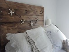 Reclaimed headboard...who needs a fancy schmancy bedroom set; this has so much more character.
