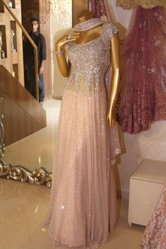 really love this one. the sparkle, the cap sleeves, the color, the shape