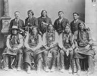 (Coeur d'Alene Tribe) Tom Costello, back row, extreme left, Indian agent for the Cd'A Indians, 1891 Treaty, a year after Idaho became a state. Later elected Sheriff of Kootenai County. Chierf Seltice is in front row, center.  [From: Museum of North Idaho: Exhibits: museumni.org]