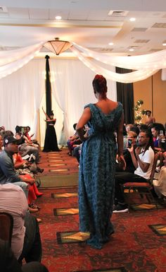 Teal Rose Grecian Dress.by Jan King Designs. 2016 Beauty and Brains Fashion Show Nashville, TN - TwoSistersPhoto Jan King Designs Black Rose Skirt and Halter top with feather headpiece. 2016 Jan King Designs.Beauty and Brains - TwoSistersPhoto