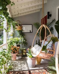 Hanging plants make this terrace incredible boho. Pruned plants can likewise do equally and are best organized with hanging egg chair. Pick multiple cushions for the chair to ensure comfort in this plan along classic rug. The wall mirror will add bohemian vibe even more to this spot of your home.