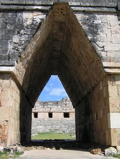 Maya Arch, Uxmal, Yucatan, Mexico  This is a well known view through the biggest arch (actually leading through wall) in Uxmal, the archeological site. It leads to a wonderfully preserved square with some of the best decorated Maya structures you can see anywhere