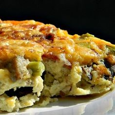 This cheesy egg casserole with onion, bacon, and potatoes is like a gluten-free quiche, sure to be a crowd-pleaser at breakfast or brunch. Breakfast And Brunch, Best Breakfast Casserole, Paleo Breakfast, Breakfast Dishes, Breakfast Recipes, Breakfast Ideas, Brunch Recipes, Brunch Ideas, Brunch Casserole