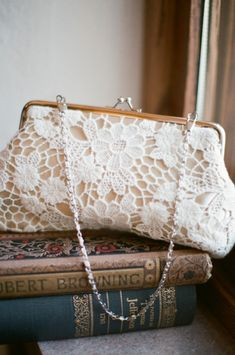 A bride's clutch on books
