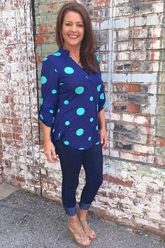"""Our Navy Blue & Mint Polka Dot Top with Roll Tab Sleeves is made of 92% Polyester and 8% Spandex and measures approximately 31"""" long from shoulder to hem.  This top is available in sizes Small, Medium, and Large."""