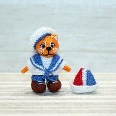 Miniature knitted red cat sailor