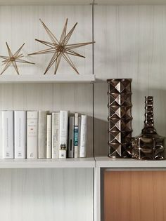Bold pieces of décor instantly add a touch of glam to your bookshelf.