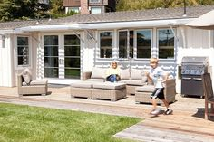back deck of 1950s Marin bungalow redo by Feldman Architecture light wood + light furniture