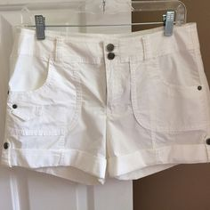 INC White Cargo Shorts 6 NWT Cute INC. International Concepts brand cargo shorts with silver buttons, size 6, white. Two pockets on front, two on back. Can be rolled up (as shown in photo) or down. INC International Concepts Shorts Cargos