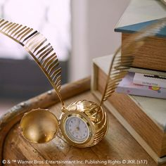 HARRY POTTER™ GOLDEN SNITCH™ Clock. Time flies! Catch your ride (and maybe a SNITCH™!) just in time with help from this shining clock. Featuring a gilded and spell-binding design, it's a magical addition to your room's decor.