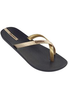 Gold and black flip flop made of 100% recyclable material. Flip flop has a black sole and crisscrossed straps in metallic and matte gold by Ipanema Flip Flops, $23.00