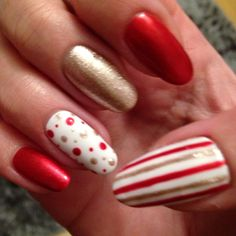 Festive red and gold dot and stripe gel nails