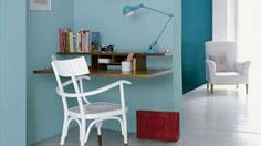 Contrast hazy blue with bold teal for an inspiring office impact.