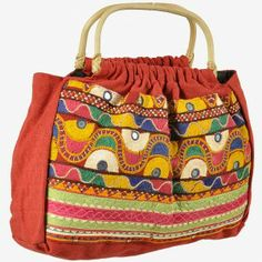 Hand Bags MRP:Rs.650/- Order Here http://www.artncraftemporio.com/hand-bags-2009.html  Product Description This trendy colourful hand bag presents a good example of traditional craftsmanship of Rajasthan. This ethnic bag is enriched with handmade embroidery by women working in Barmer district of Rajasthan. It is adorned with embroidered work in luscious colours and graced with mirrors. It has a cane wood handle for a perfect finish.